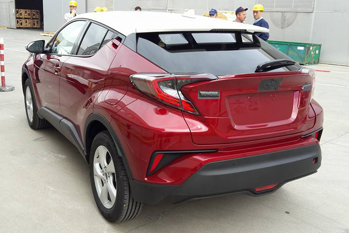 toyota c-hr red white rear quarter