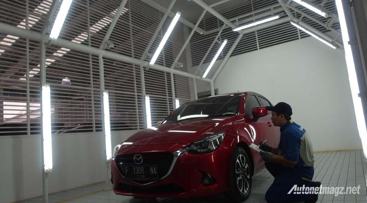 perbaikan bodi Mazda 2